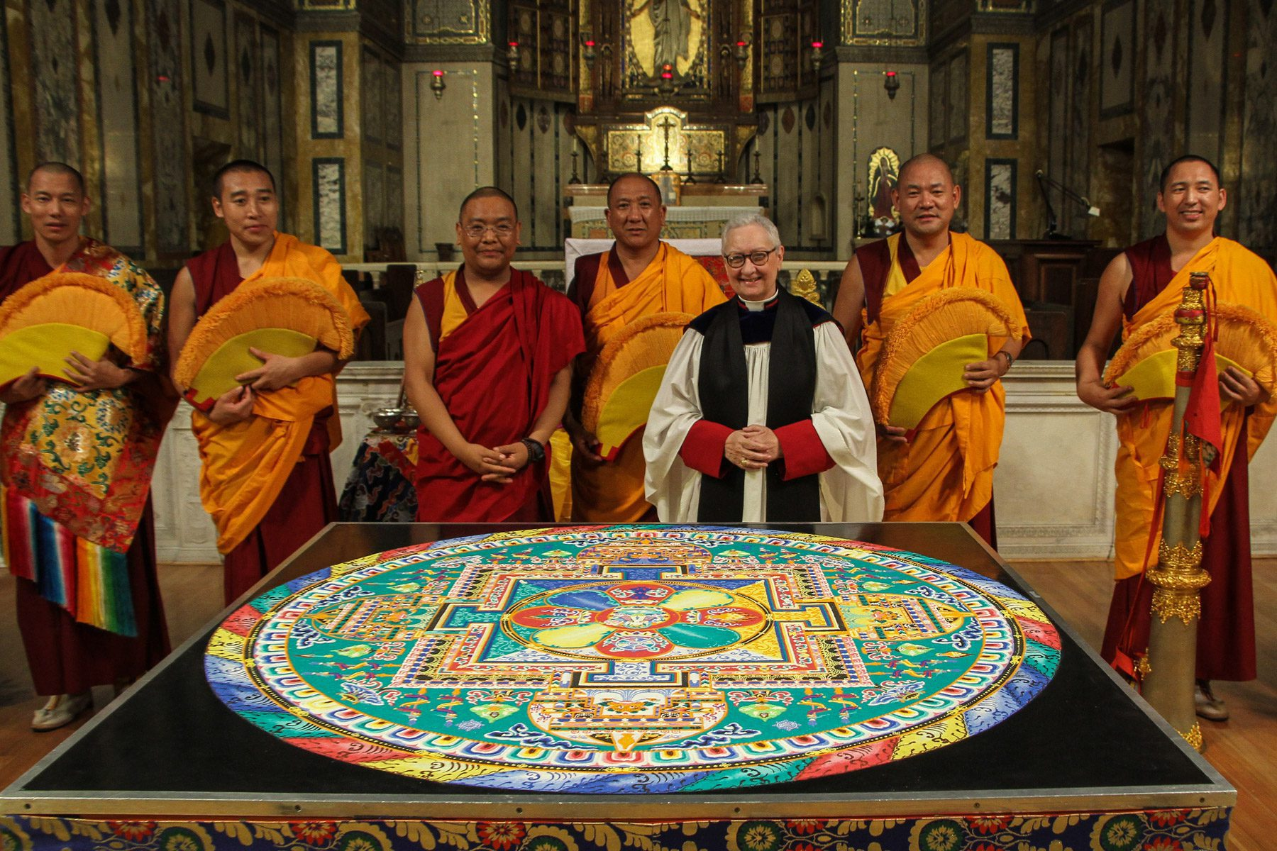 The monks and Dr. Guibord with the Mandala of Compassion
