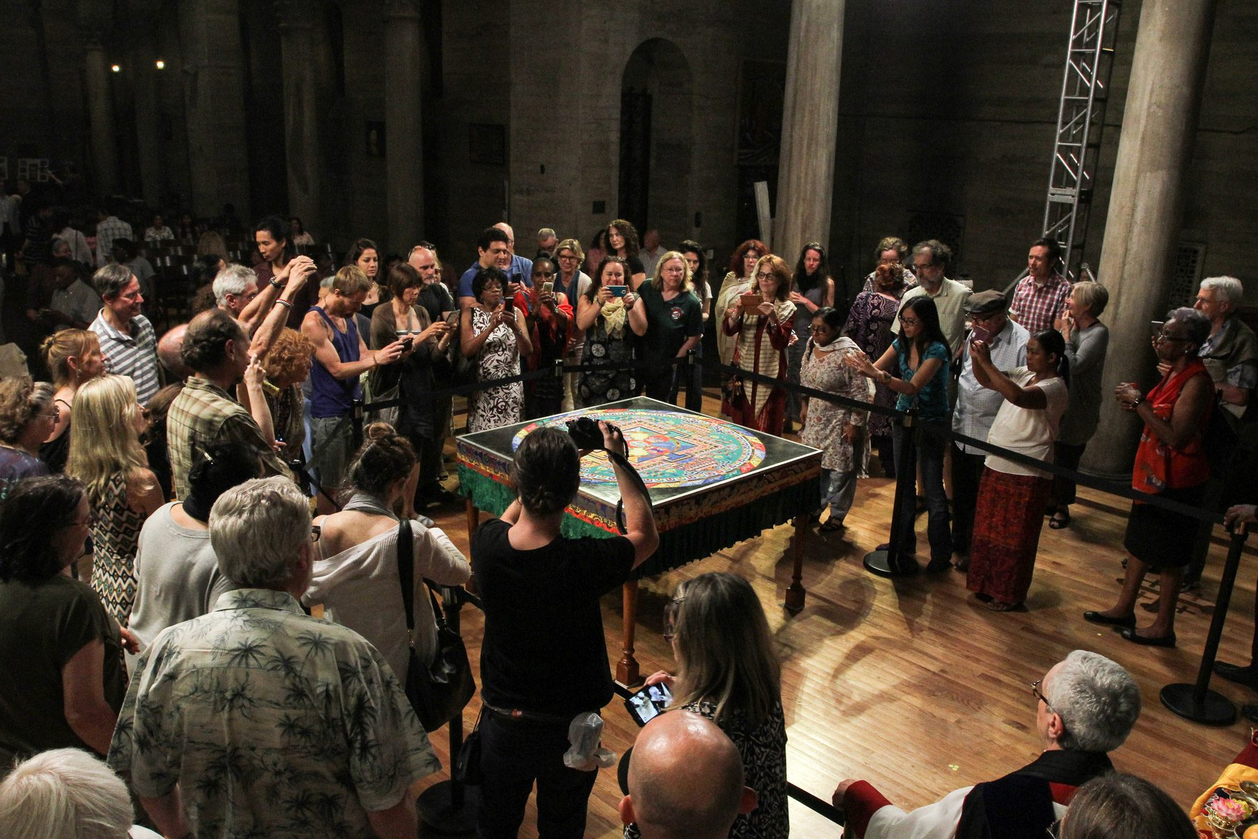 Audience photographs the Mandala of Compassion