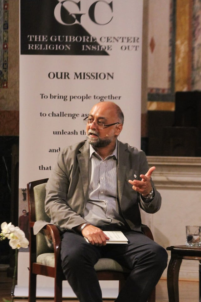 Amir Hussain with book Muslims in America
